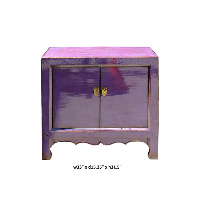 This is a short sideboard credenza cabinet table with two doors compartment storage. It is finished with distressed purple...