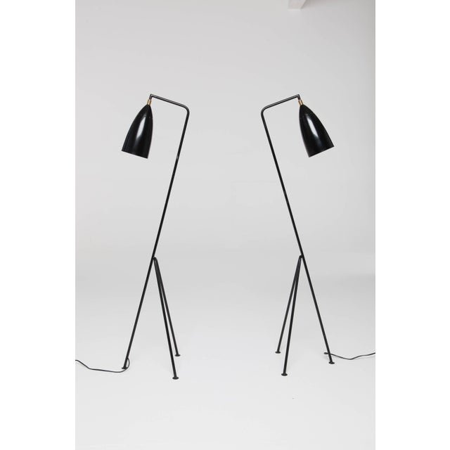 A pair of Mid-Century 'Grasshopper' lamps in the manner of Greta Grossman, probably Italian, 1960s-1970s. Perforated...