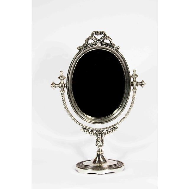 """Silver plated mirror with single side mirrored. Made in Italy. Measures 18"""" high and 11"""" wide."""