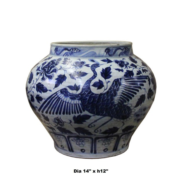 This is a Chinese decorative porcelain vase pot in Blue and White color finish. The theme is oriental scenery graphic. It...
