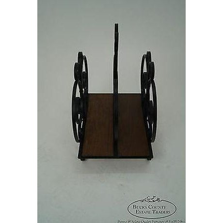 High quality, custom made, black, wrought iron magazine stand w/ walnut panel bottom.