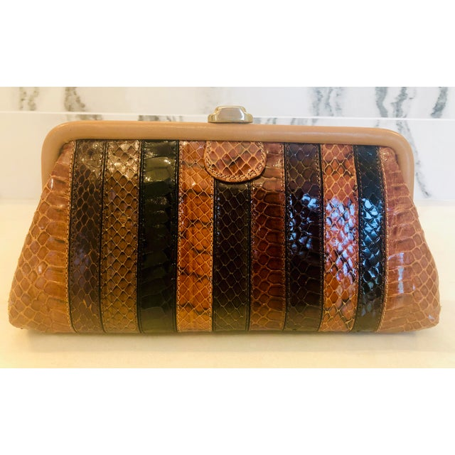 Dramatic 1980s Borsettificio Patrizia python clutch with alternating strips of python skin. The reverse side is made of...