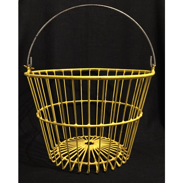 Nice, large farm or industrial wire basket with yellow vinyl coated body and plain wire handle. Ample size for use in the...