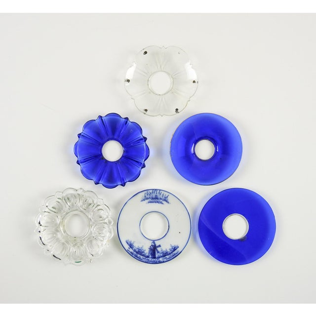 Group of mixed vintage bobeches in blue and clear. One blue and white porcelain Delft, two clear glass, three cobalt blue...