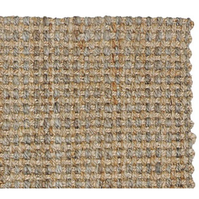 Variations in the color of the natural jute fibers add another layer of visual interest to our handwoven Costa Rica rug,...