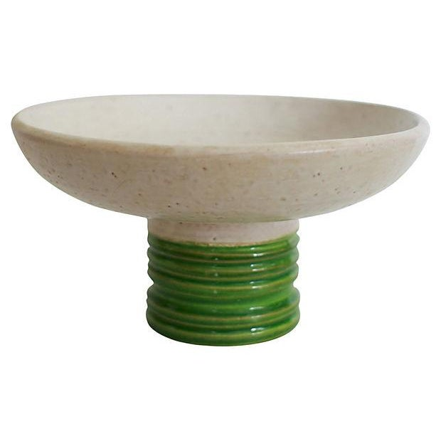 """Mid-century Italian pottery pedestal bowl with a ribbed green base detail. Original label reads """"Created in Italy for..."""