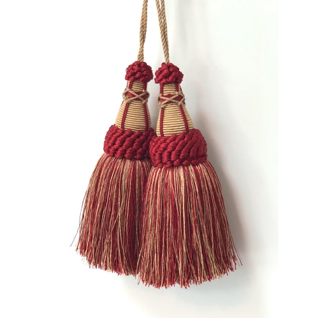 Pair of handmade red & gold colored key tassels with looped ruche, twisted cord and full skirt. This tassel is a true ruby...