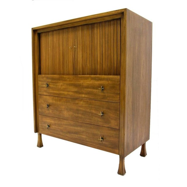 John Widdicomb tall dresser with tamboured doors that conceal several cubbies and one small drawer. The ample sized lower...