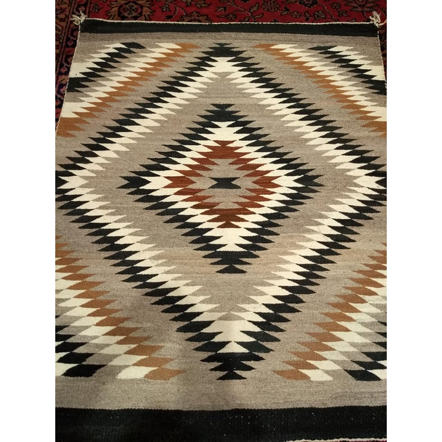 This Navajo rug in Eye Dazzler design is in beautiful earth tone colors. The Navajo carpets have become very collatable...