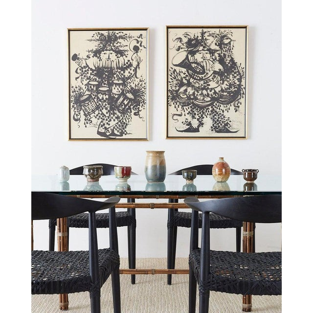 Whimsical pair of framed lithographs by Bjorn Wiinblad (Danish 1918-2006) depicting two festive musicians playing a French...