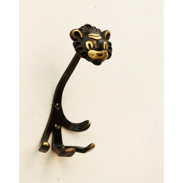 This 'Lion' brass hook was designed by Walter Bosse for Hertha Baller and produced in Vienna from the 1950s. The piece is...