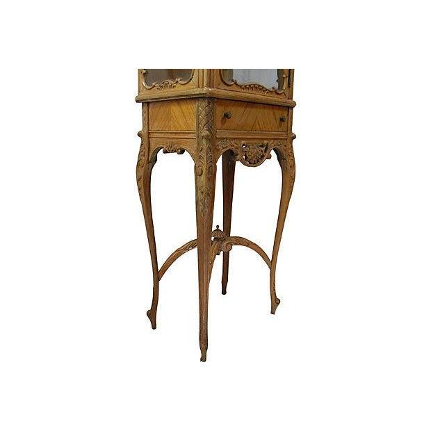 Petite vintage curio cabinet by John M Smythe Furniture Co. Delicately carved floral detail, with slender cabriole legs....