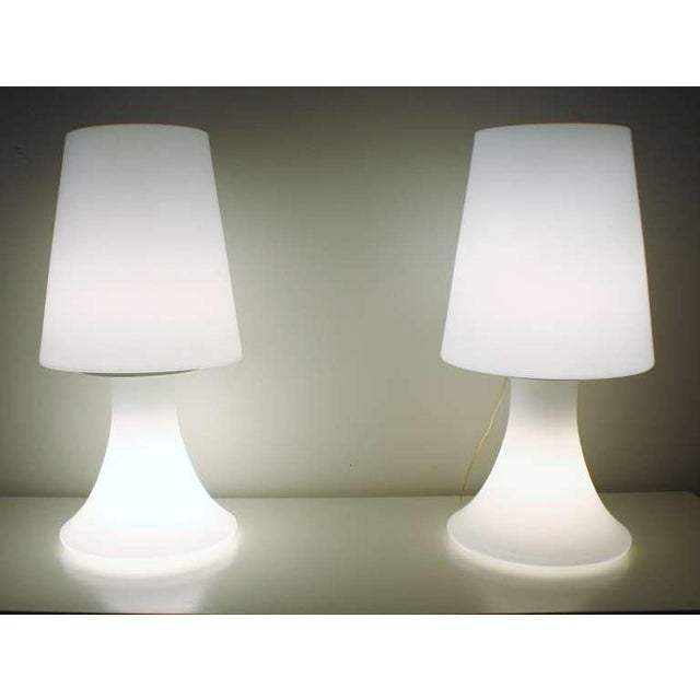 1960s Italian white glass lamps by Laurel illuminates both on the base and the glass shades. Each are wired with dimmer...
