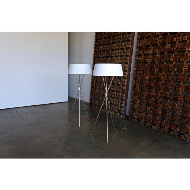 "Pair of Polished Nickel ""Tripod"" Floor Lamps by T.H. Robsjohn Gibbings for Hansen Lighting Co. circa 1955"