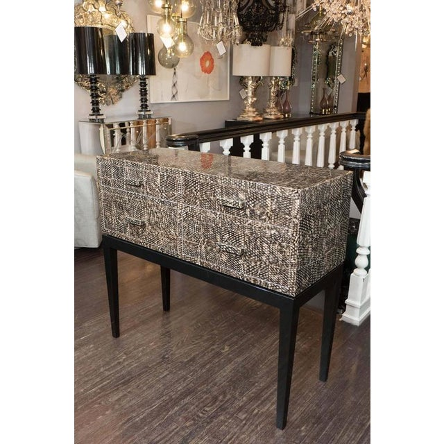 Lacquer over golden fish skin veneer console table with high-gloss black lacquer base.