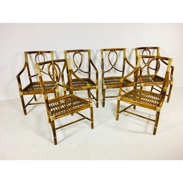 This is a vintage set of six dining chairs known as the Leona chair and made by McGuire San Francisco – SET OF 6 Rattan...