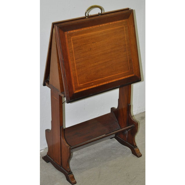 Inlaid mahogany folding art stand c. 1910. This wonderful artist portfolio stand can be used as a magazine rack, or as the...