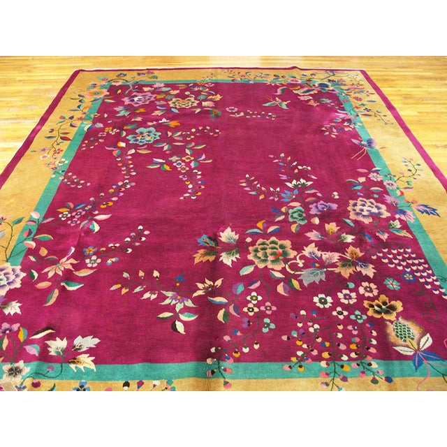 """This is a Chine art wool rug from China 1920. The size is 9'x11'8"""". The colors are tan, turquoise, fuchsia, pink, purple,..."""