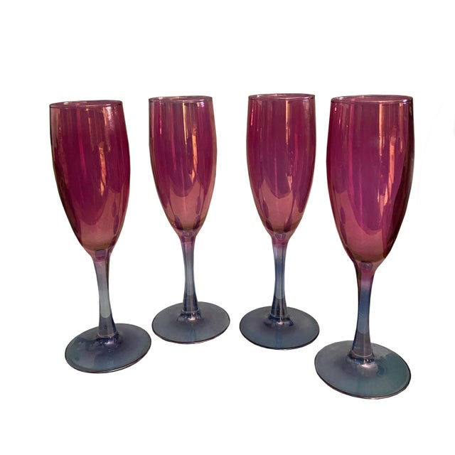 A set of four vintage wine glasses in a very pretty cranberry pink color that transitions to an amethyst stem. A great set...