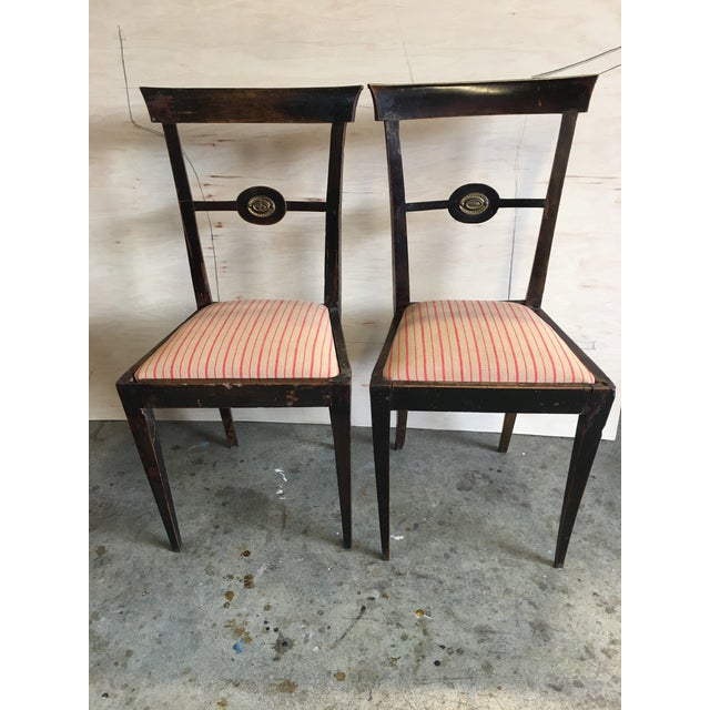 Pair of darling Italian decorative chairs with stiletto tapered legs, brass medallions and new upholstery in pink and...