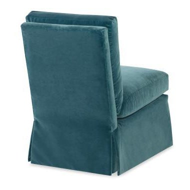 The Amelia Skirted Chair is a first quality market sample that features an Ink Blue Fabric.