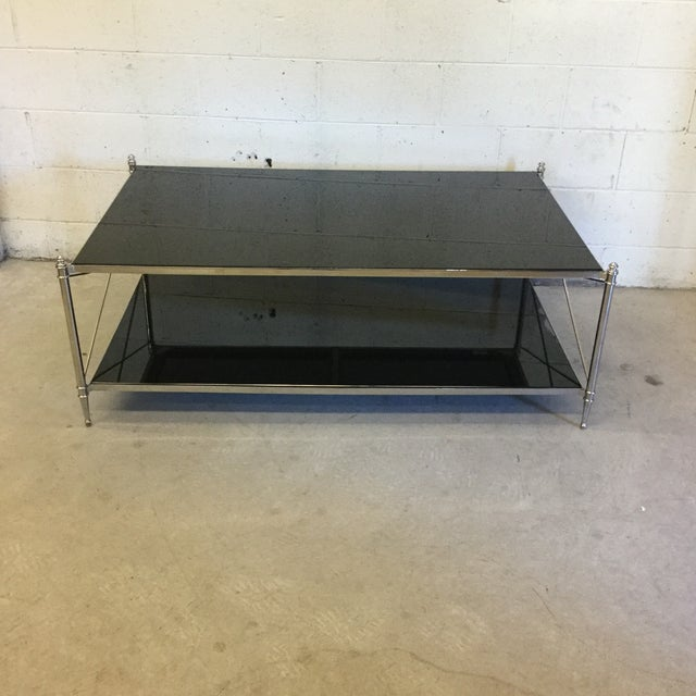 This is a showroom floor sample. This table retailed for well over $2k . Stainless steel frame, black inset glass; tubular...