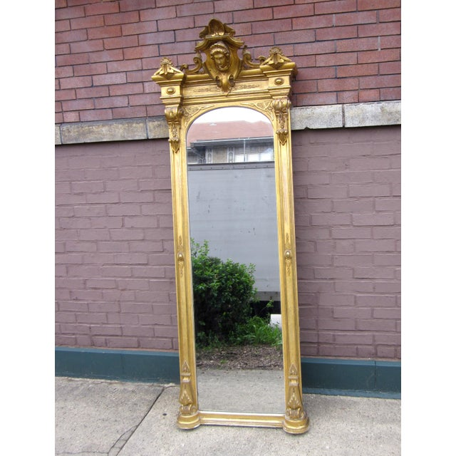 This is an absolutely stunning antique gold gilt renaissance revival style pier mirror. Its documented provenance dates it...
