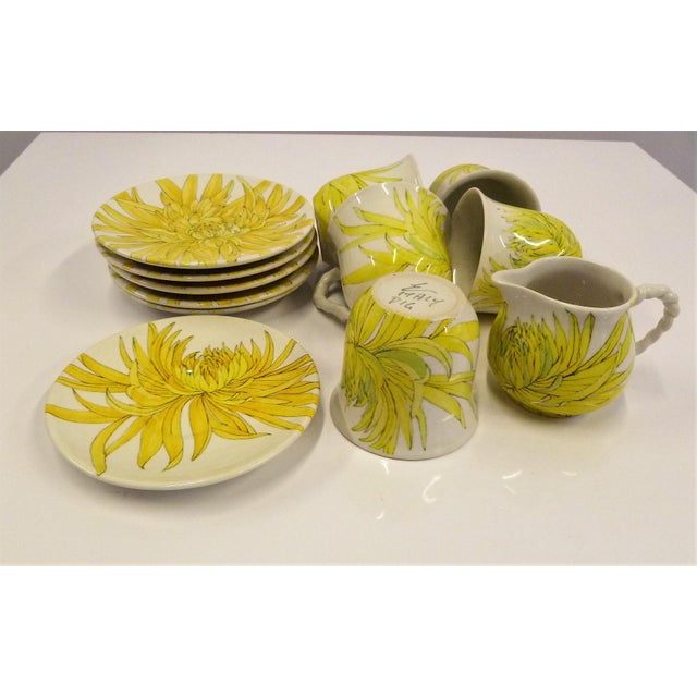 A set of 5 coffee cups and saucers plus a creamer with saucer in bright and cheerful Chrysanthemum pattern by Ceramiche...