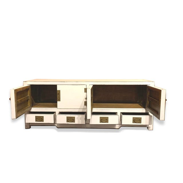 Shanghai TV stand made out of elm wood. It has 4 doors with 4 drawers at the bottom. It is very elegant piece on the...