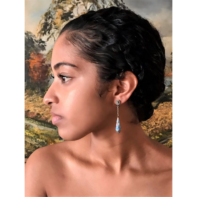 Circa 1920s to 1930s sterling silver screw back earrings with a sterling drop embellished with kingfisher feathers. Each...