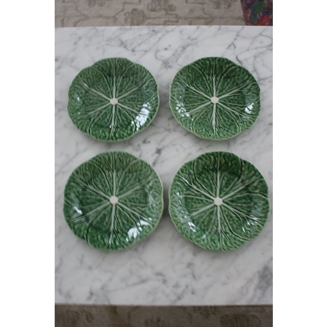 This set of 4 cabbage motif salad / dessert plates were made by Bordallo Pinheiro (stamped on bottom) in Portugal. They...