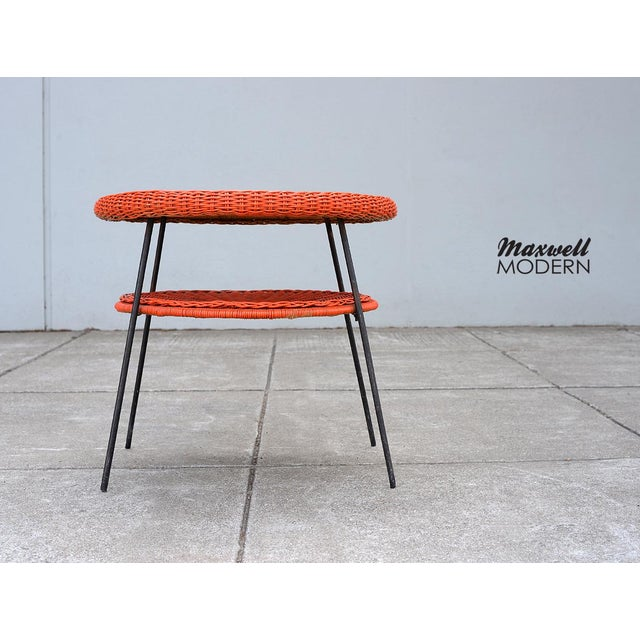 A real modernist stunner in the manner of Carl Aubock and Arthur Umanoff. This rare 1950s side table has original red...
