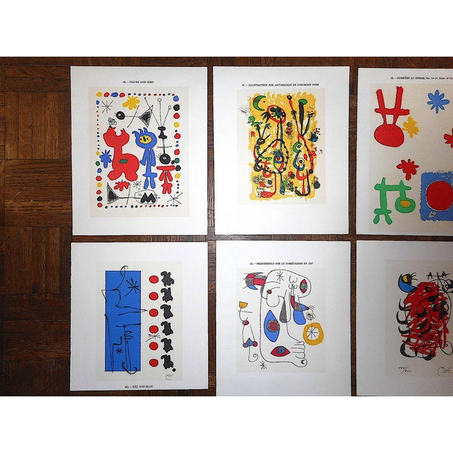 Set of eight (8) vintage abstract lithographs (offset) by the famous modernist Joan Miro (Spain, France 1893-1983)....