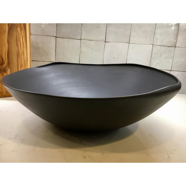 This is a standout decorative showpiece. The color is a dark bluish-black. Beautiful and in perfect condition. Retails...