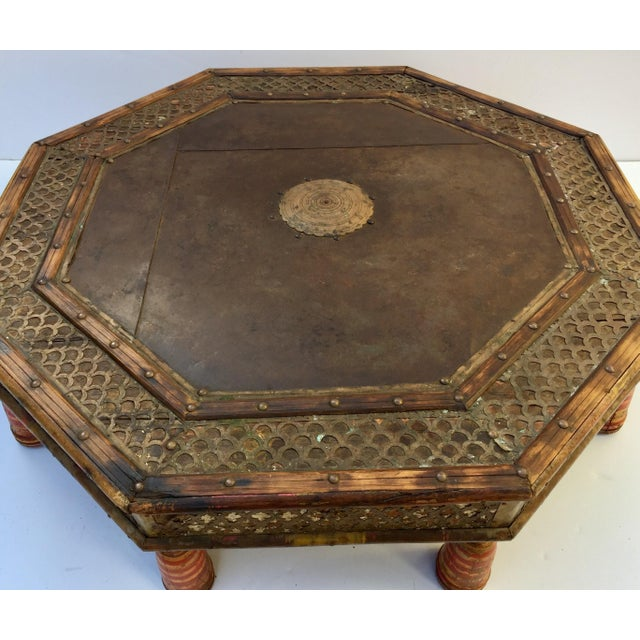 Great octagonal Anglo Raj round tribal low table, made of wood, metal, brass and iron and decorated with brass filigree...
