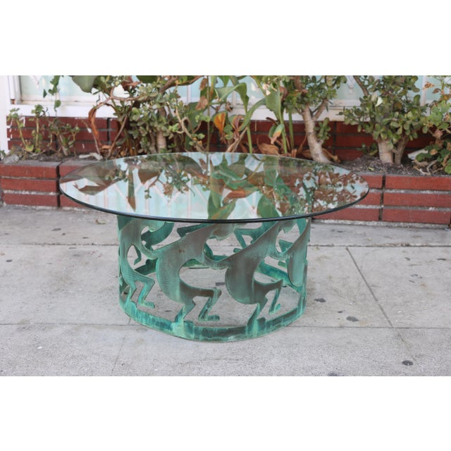 Vintage Low Bronze low coffee table in well kept condition. No damages or chips on glass or the bronze base. The table is...