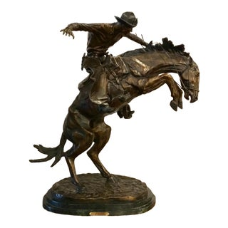 """""""Bronco Buster"""" Signed By: Frederic Remington Bronze Horse and Rider Sculpture For Sale"""