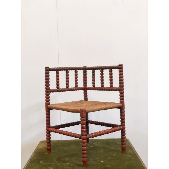 Vintage 1940s French turned wood corner chair with rush seating.