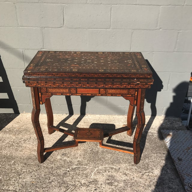 Gorgeous late 1800's or early 1900's antique Syrian inlaid marquetry game table with mother of pearl and exotic woods....
