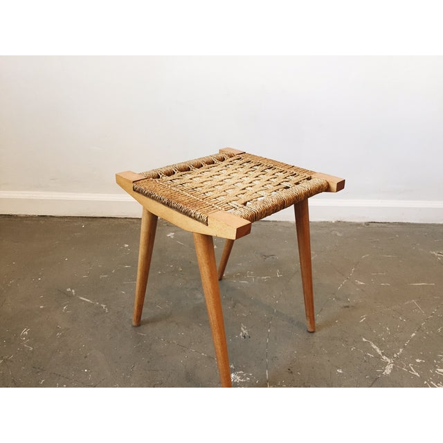 Beautiful vintage stool with a woven seat. In excellent condition.
