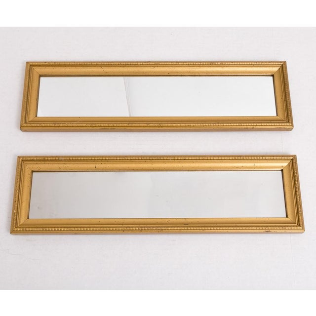 Wonderful classic pair of gold finish wood wall mirrors, circa 1950-60s. This versatile pair can be used together or...