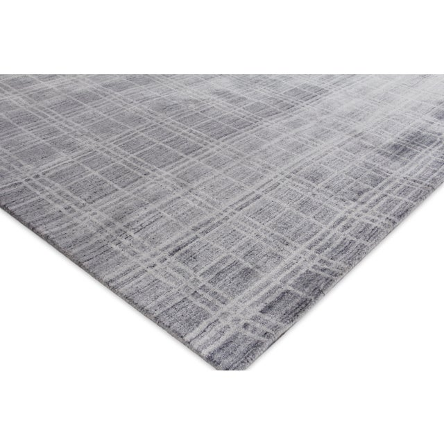 The Fairbanks rug catches your eye with its sharp and fresh plaid pattern motif, soft sheen and soothing colors....