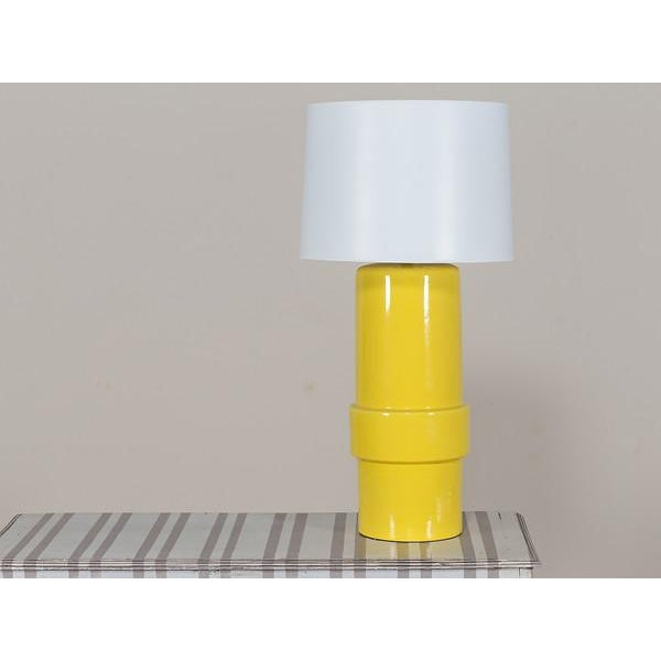 The brilliantly rich yellow of this vintage Italian lamp circa 1970 evokes the era of La Dolce Vita. The cylindrical shape...