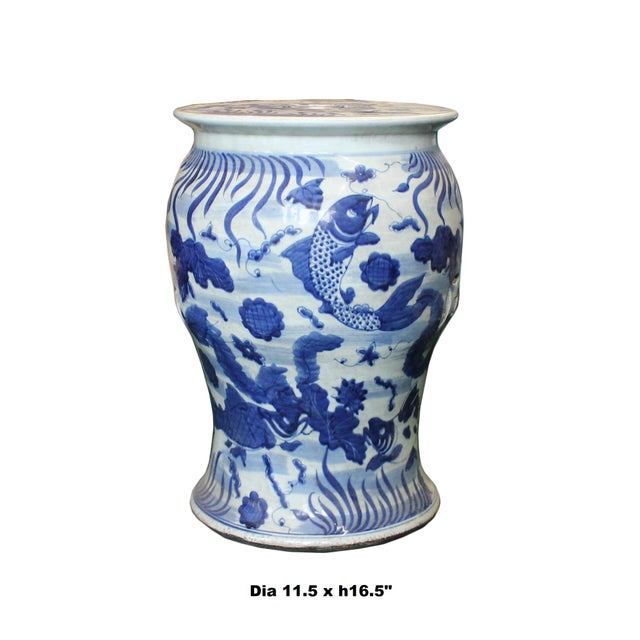 This is a hand painted distressed blue & white porcelain stool in white base color with blue fishes graphic pattern....