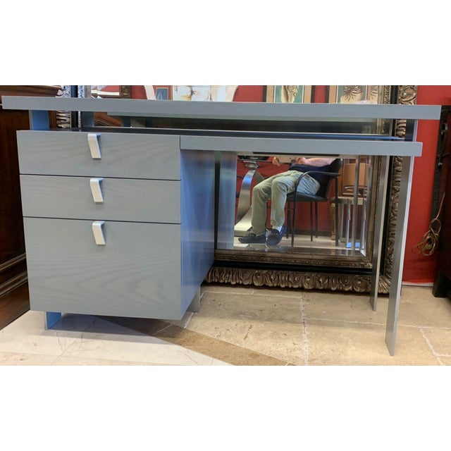 Antoine Proulx Desk This contemporary desk has a kind 1939 Worlds Fair industrial optimism to it. The gray, cerused oak...