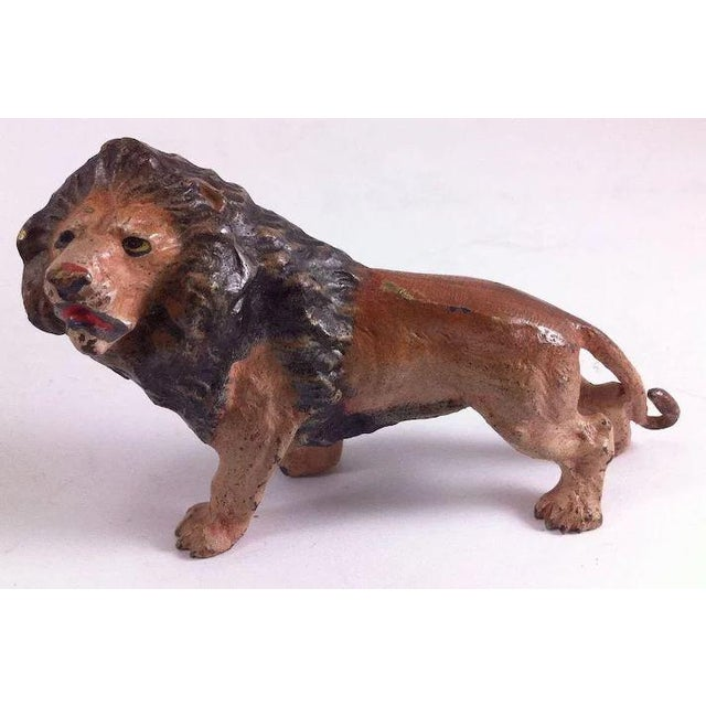 This is a very nice depiction of a lion, the king of the jungle, in bronze with a cold paint finish. It measures about 4...