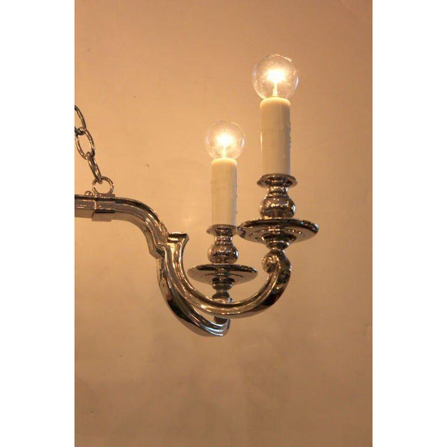 Antique Neoclassical Nickel Plated Bronze 8 Arm Chandelier. Later electrified and nickel plated.