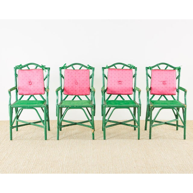 Maximalist Trompe l'oeil card or poker games table with four matching rattan armchairs. The table features a needlepoint...