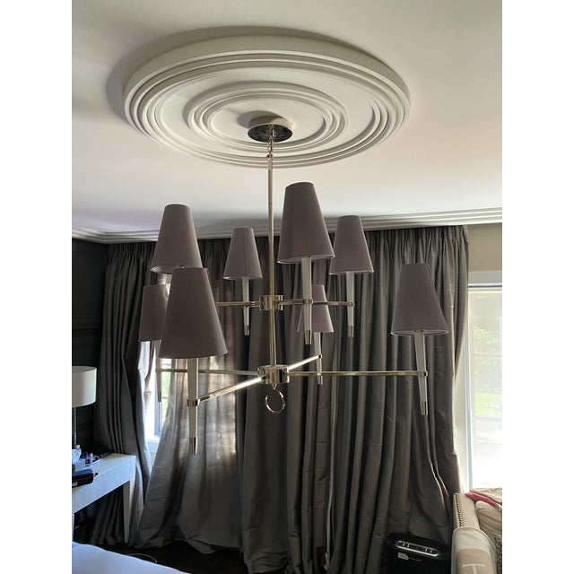 Jonathan Adler silver two-tier chandelier with individual, tapered shade coverings. Made of wood and steel. Overall:...