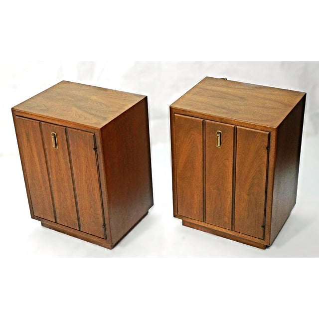 On offer on this occasion is a pair of beautiful American modernist walnut night stands/cabinets with interior shelf....